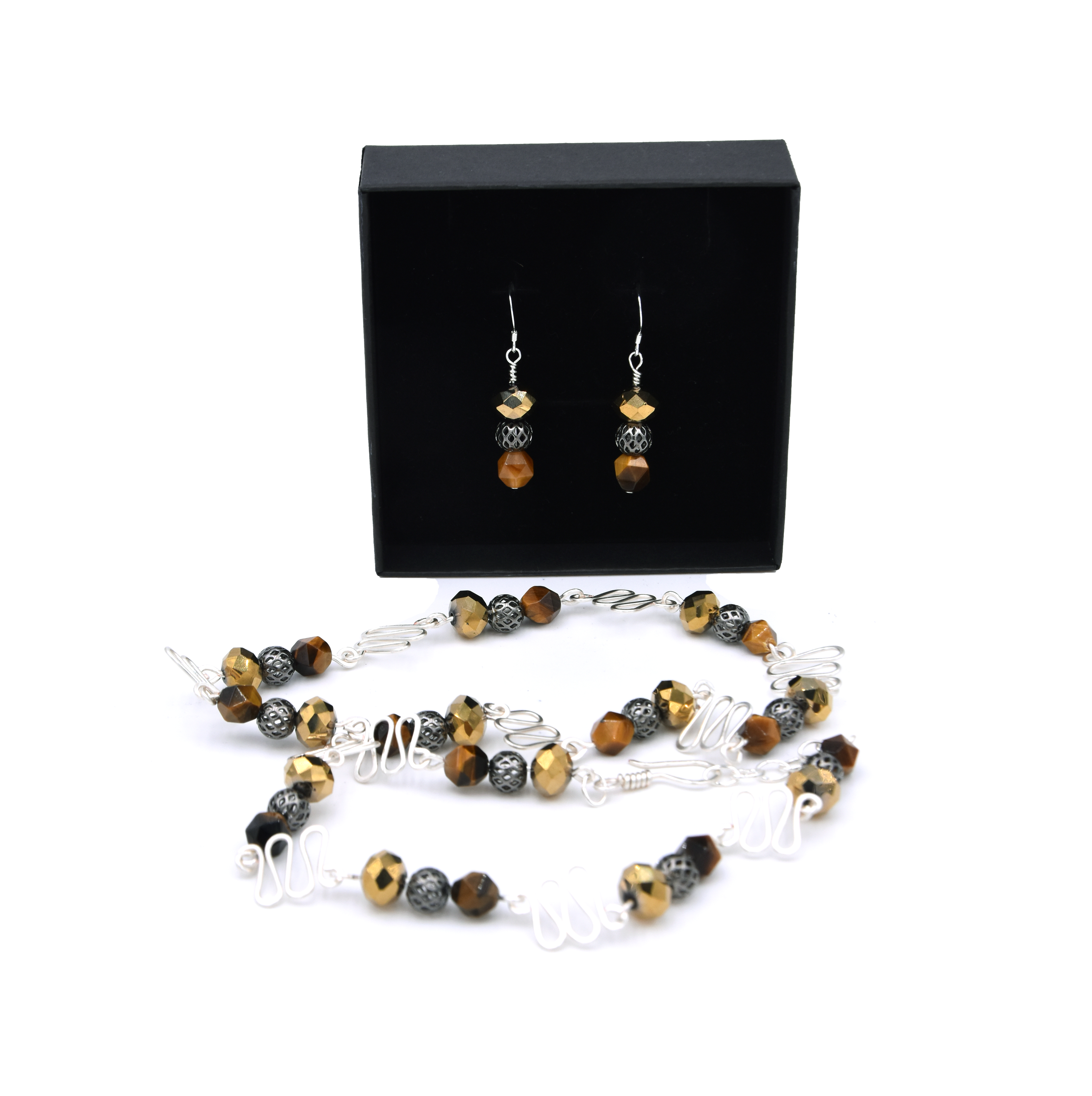 Gabriella Szekely jewellery - filigree and glass bead pendant and earing as a set displayed in a jewellery box - silver beads golden glass bead and tiger eye brown orange beads with handmade findings 2