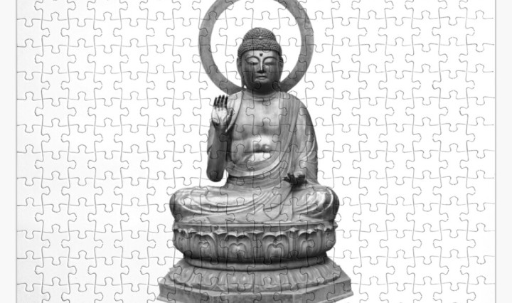 buddah sitting puzzle pieces